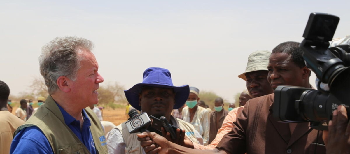 WFP executive director answering media questions in the field