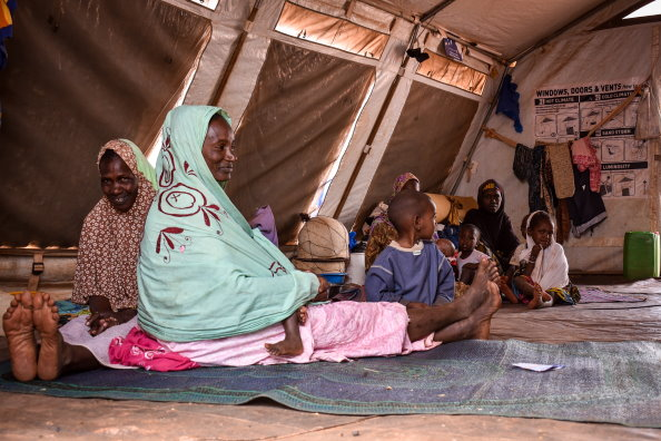 A family in an Internally Displaced Persons Camp in Sévaré, Mopti Region, February 2020, Photo: WFP/Benoît Lognoné