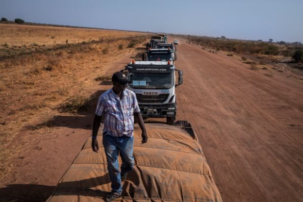 Photo: WFP/Gabriela Vivacqua. A WFP convoy leader inspects the cargo on a truck. Some 150 South Sudanese registered haulage companies are on WFP's books. With a combined fleet of 8,200 trucks, they employ more than 16,600 South Sudanese truck drivers and assistants. These jobs provide much-needed income in many areas of the country