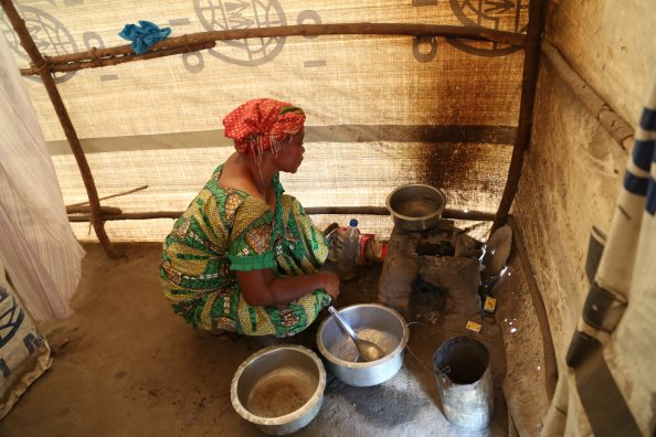 Photo: WFP/Deborah Nguyen, WFP food assistance beneficiary getting ready to prepare a meal for her family, Tanganyika, Kalemie (DRC)
