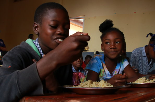 Photo: WFP/ Alexis Masciarelli, WFP's school feeding programme is considered the largest food safety net in Haiti.