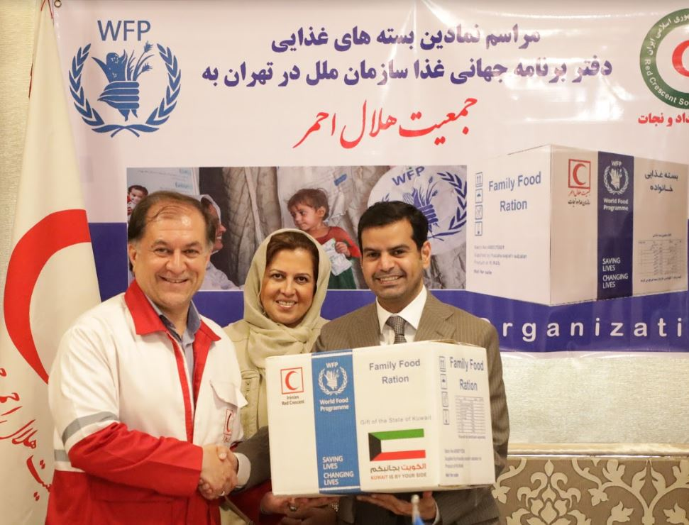 From left to right: Falah al-Hajarf, acting Minister of the Kuwaiti Embassy to Iran, Negar Gerami, WFP Country Director in Iran, and Morteza Salimi, President of The Iranian Relief and Rescue Organization. Photo: WFP/Neda Mobarra