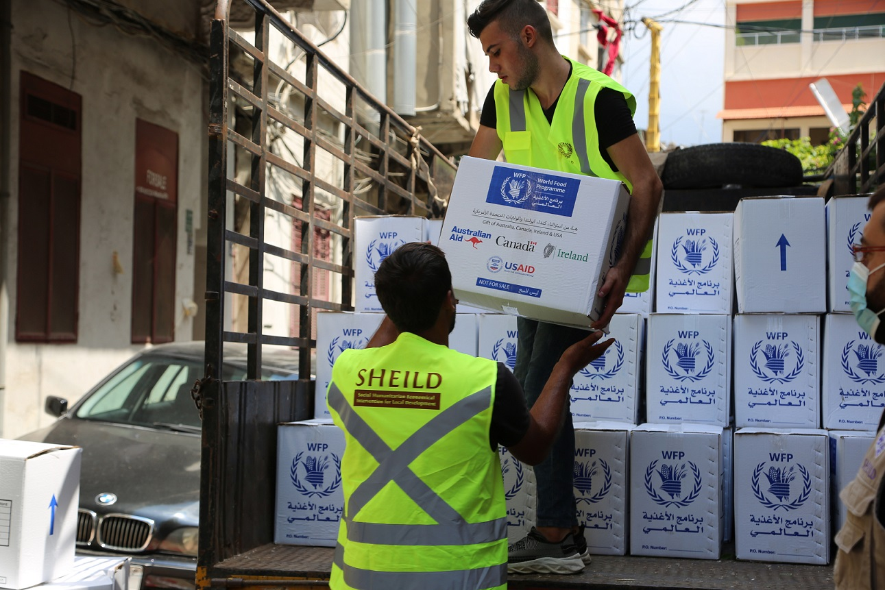 Workers unload WFP food aid at the Karageusian Center in Beirut, Lebanon - WFP/ Ziad_Rizkallah