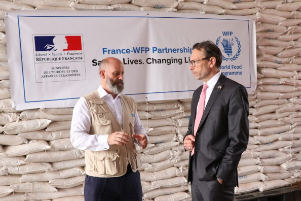 Photo: WFP/Musa Mahadi, Matthew Hollingworth WFP's Country Director in South Sudan and H.E Marc Trouyet, French Ambassador to South Sudan at a WFP warehouse in the capital Juba.