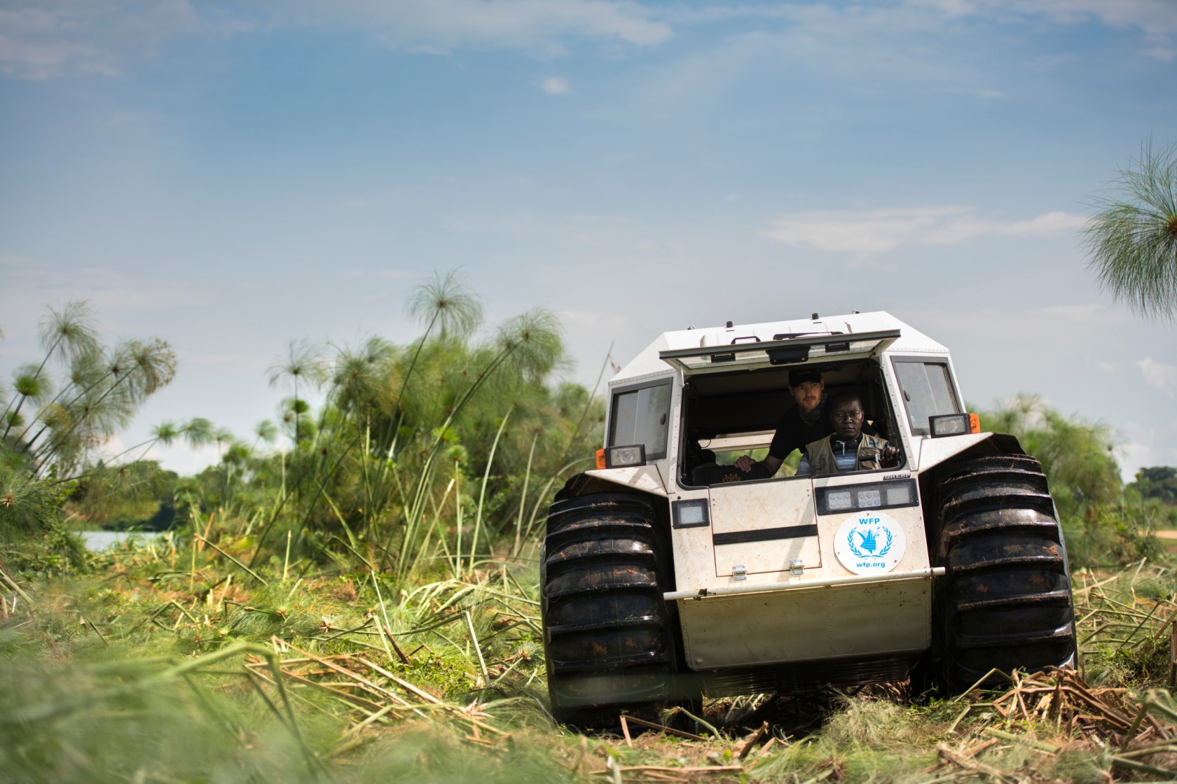 A Sherp traveling through swamp lands to save lives