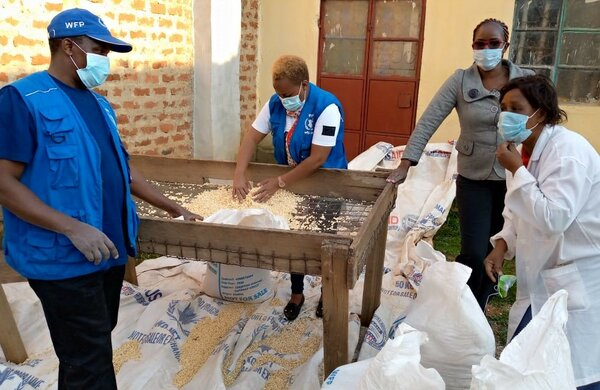 Caroline (C) checks the quality of maize before purchase. Damaged kernels and impurities such as stones must be removed (R). Photos: WFP