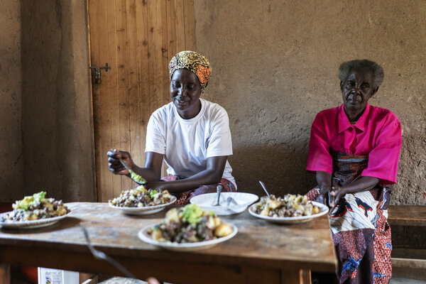 Two women sitting and eating a meal