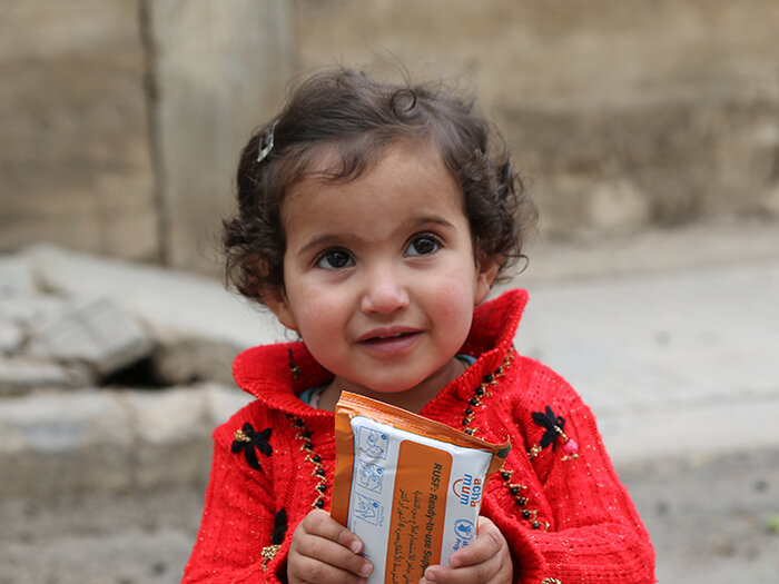a girl with wfp food