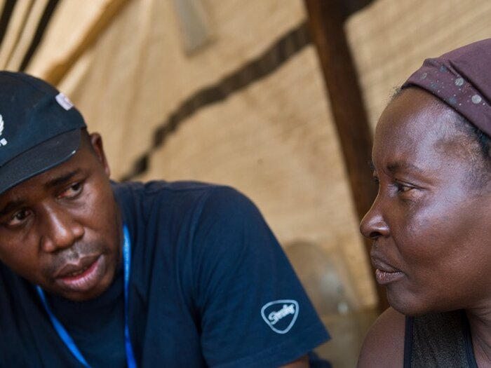 WFP staff interviewing woman