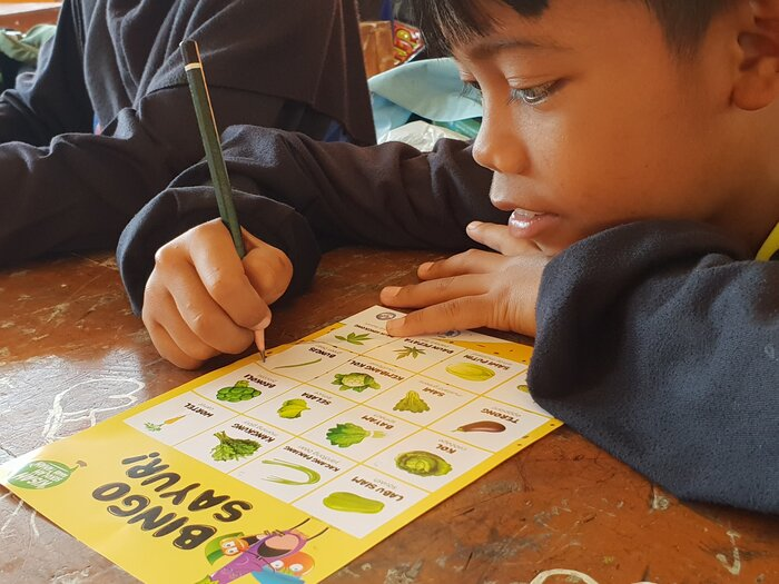 A child is studying in classroom