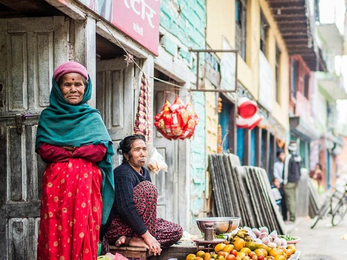 women are selling fruits in the street