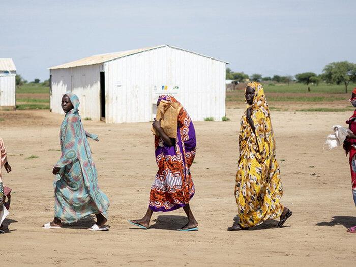 women walking in line