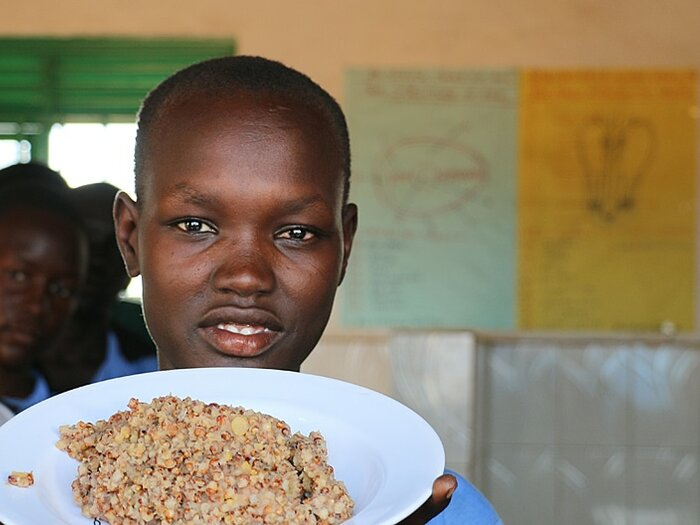 Boy with plate of food