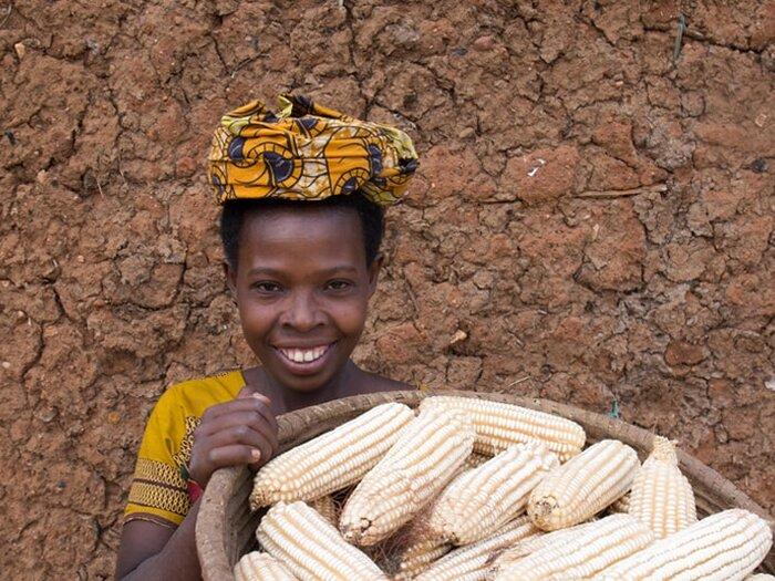 girl with basket full of corn