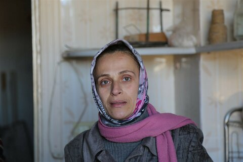 Homeless for six years, Syrian mother returns to Aleppo