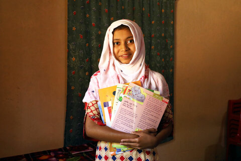 Education day: A schoolgirl in Bangladesh reads her way to success