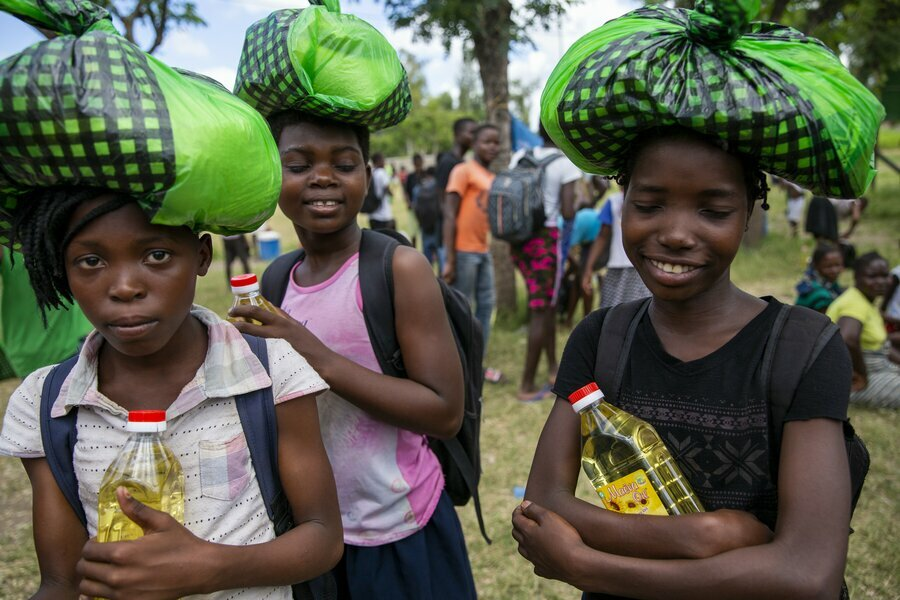 Schoolgirls in Beira, Mozambique, taking home rations before schools closed in April. Photo: Karel Prinsloo/Arete/UN Mozambique