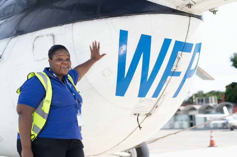 Robine is 25 years old and helps to arrange and monitor flights, as well as guide passengers and cargo onto the aircraft. Photo: WFP/Antoine Vallas