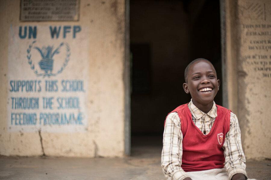 Boy at outside school in Uganda
