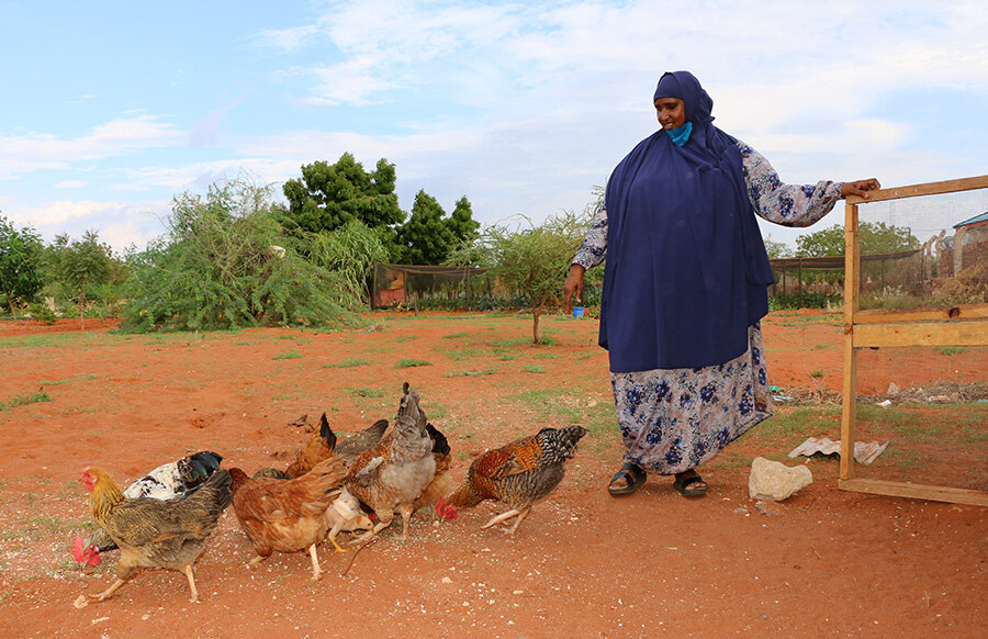 Habiba is pictured with her chickens