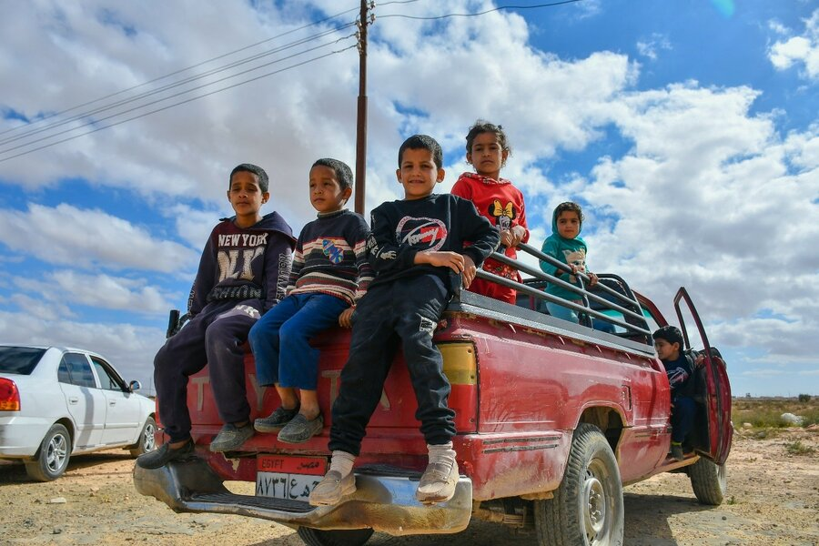 Five of Mahmoud's children sit in the back of a pickup truck on their way to the town centre.