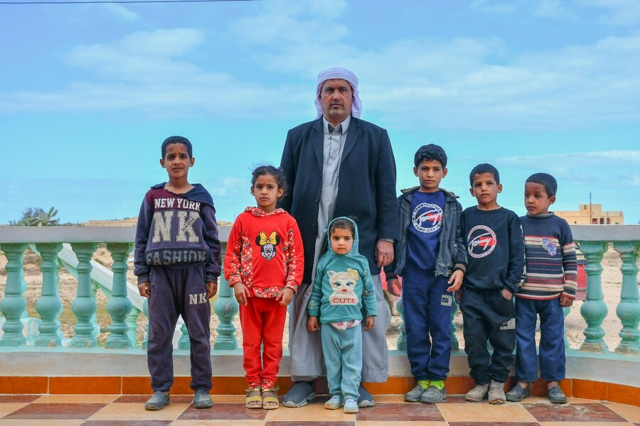 Mahmoud surrounded by six of his children, two girls and four boys.