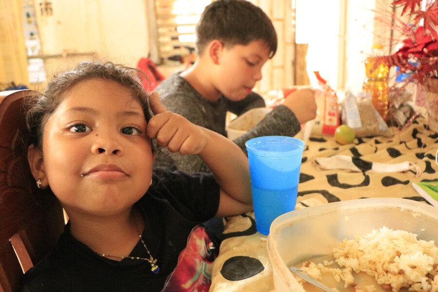 Kim eats lunch at home in La Vela de Coro, Venezuela