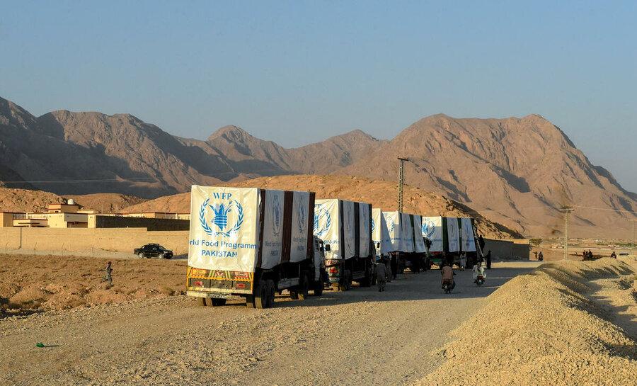 convoy of WFP trucks in arid landscape