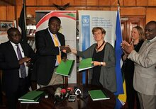 Hon. Eugene L. Wamalwa, Cabinet Secretary, Ministry of Devolution and the ASALs and H.E. Annalisa Conte WFP Representative and Country Director, shaking hands after having signed the Agreement.