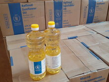 Photo: WFP/ Esther Ouba, fortified vegetable oil from donated from the Russian Federation to vulnerable people of Burkina Faso