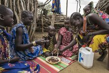 Photo: WFP/ Gabriela Vivacqua, A family enjoys a meal together in Kapoeta, South Sudan. Without assistance most families were resorting to skipping meals or reducing meal portions to tide the tough times.