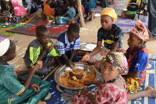 people eating together in Mali