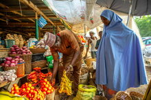 WFP/Arete/Adetona Omokanye, Women buys tomatoes in Yankaaba Market in Kano, Nigeria on 11th April, 2021. Many people in Nigeria are struggling to support their families due to rapidly escalating food prices.