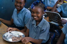 Photo: WFP/Antoine Vallas, a schoolgirl in Bouraly school, Gonaives, Haiti, who receives daily hot meals supported by WFP.