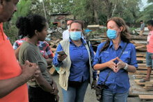 Photo: WFP/Oscar Duarte. WFP Representative, Giorgia Testolin (right), meets local community leaders at one of Bilwi's neighbours devastated by Hurricane Eta.