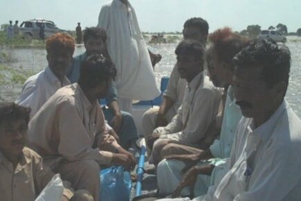 Pakistan: Boats Bring Food To Families Cut Off By Floods