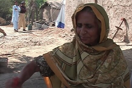 Pakistan Family Survives On Food Aid While Waiting For Flood Waters To Recede